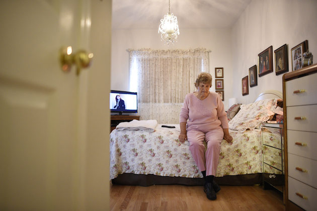 Doris Galloway in her bedroom at her Oshawa, Ont. home on July 1 2015.  TerryLe Blanc had no idea what to expect from Ontario's home-care system when he brought his elderly mother, Doris Galloway, home after she recovered from a badly broken shoulder.  Ms. Galloway, now 86, was living alone in Oshawa, just east of Toronto, when she fell in December, 2013. She lay on the floor for three days before police broke down her door at the urging of Mr. Le Blanc, who lived in Vancouver at the time.  The 55-year-old has since quit his hospital telecom job, given up his west coast apartment and moved in with his mother to care for her around the clock as she sinks deeper into the grip of dementia.   The two are photographed in their Oshawa, Ont. home and at lunch at a local fish and chip restaurant , on July 1 2015. (Fred Lum/The Globe and Mail)