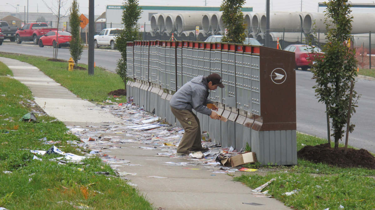 CHARGES MAY APPLY  Subject: fixer photo for Mon. Nov. 21 (to go with ci-fixernov20) On 2011-11-20, at 1:39 PM, Lakey, Jack wrote: Cut line info; Many people would rather toss their junk mail on the ground at a Canada Post community mailbox on City View Blvd. in Vaughan than take it home, including this man, who dropped anything he didn't want at his feet. JACK LAKEY/TORONTO STAR - NOV. 8, 2011.  IMG_4479.JPG