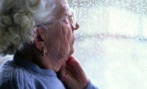 Elderly woman at window