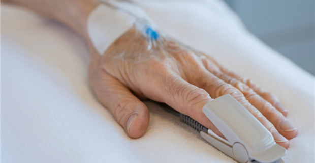 Aging Hand with heart Monitor