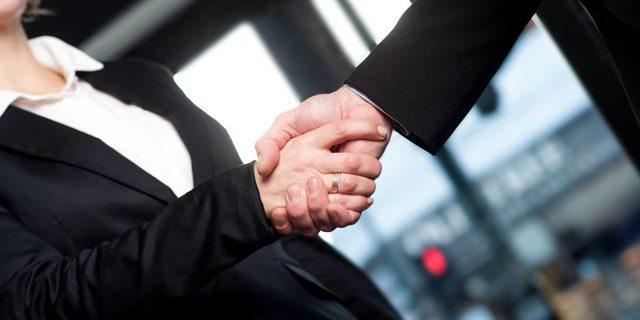 handshake business man and woman