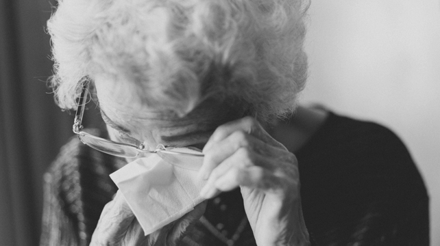 old woman crying feature crop