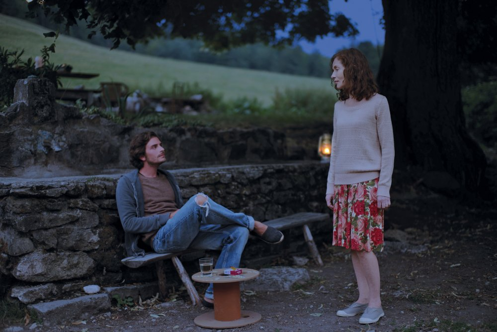 things-to-come-2016-007-roman-kolinka-isabelle-huppert-in-garden-at-twilight-original