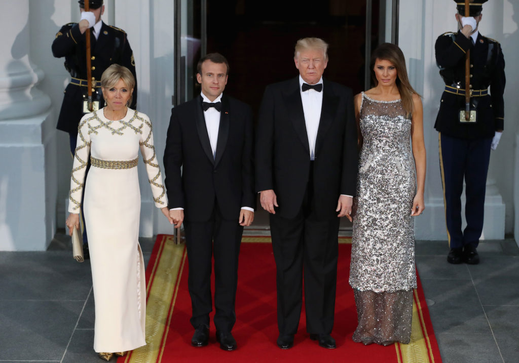 Trump Greet French President Emmanuel Ron And His Wife Brigitte As They Arrive For A State Dinner At The White House In Washington Tuesday