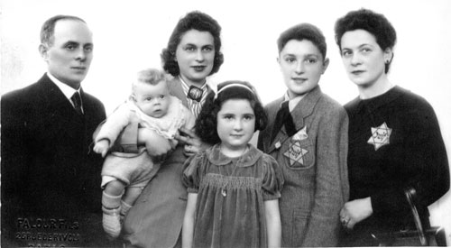 Jew Bashing - Europe: Jewish family during Holocaust period wearing identification