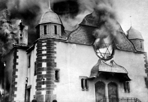 Jew Bashing - Europe: Synagogue burning during Kristalnacht WWII