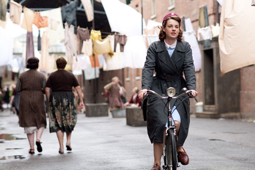 Call the Midwife: Jenny Lee (Jessica Raine) bikes through the streets of Poplar, East London Photo: Laurence Cendrowicz (c) Neal Street Productions