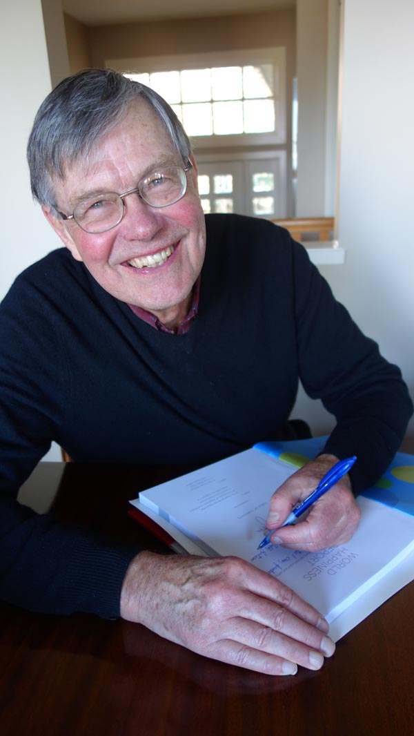 Ecstatic: Joe Helliwell, Economist who believes in promoting universal happiness signs report