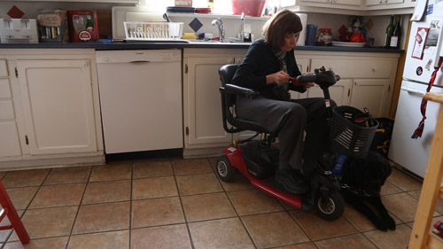 The Trouble With Dying: Linda Jarrett uses a special motorized chair to be mobile in her home