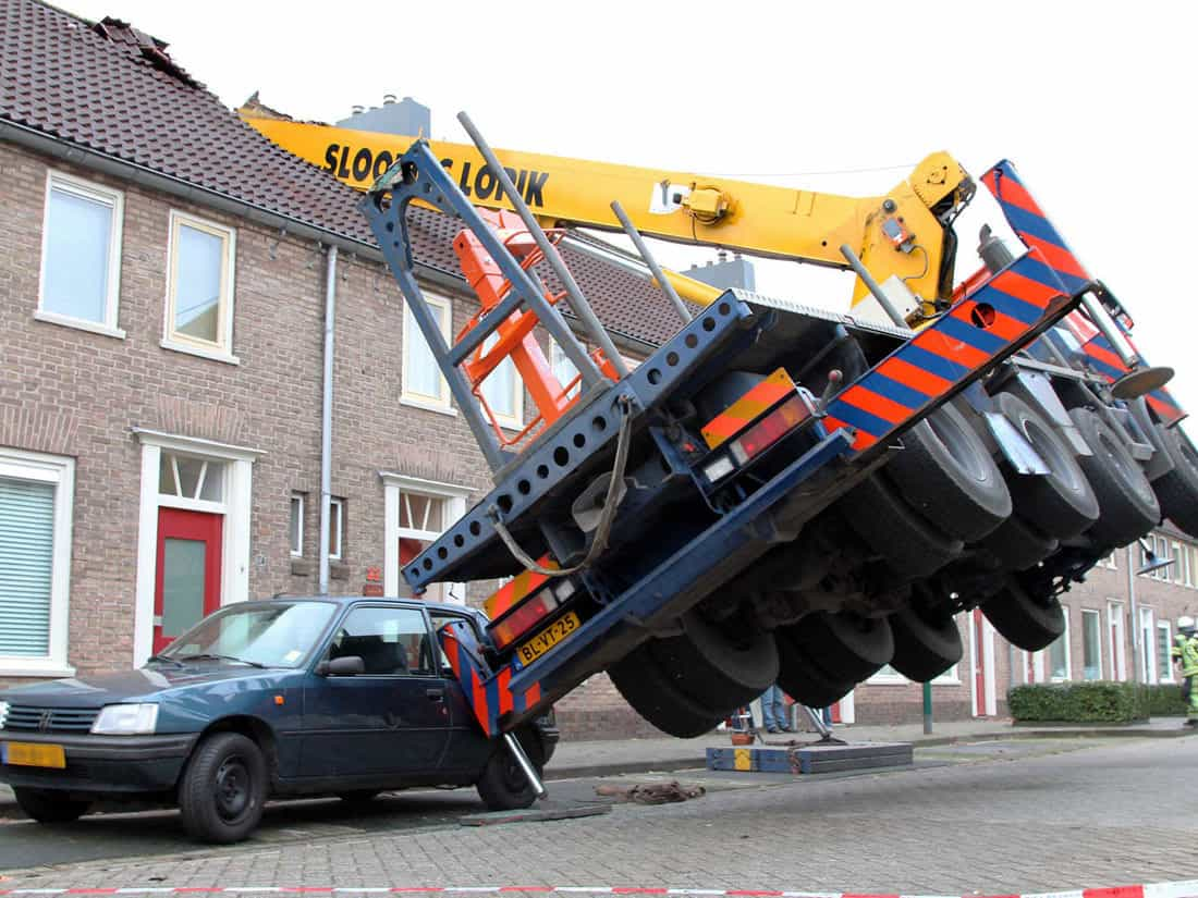 A Guy Rents a Crane For an Elaborate Marriage Proposal . . . and Accidentally Destroys His Girlfriend's Apartment Building