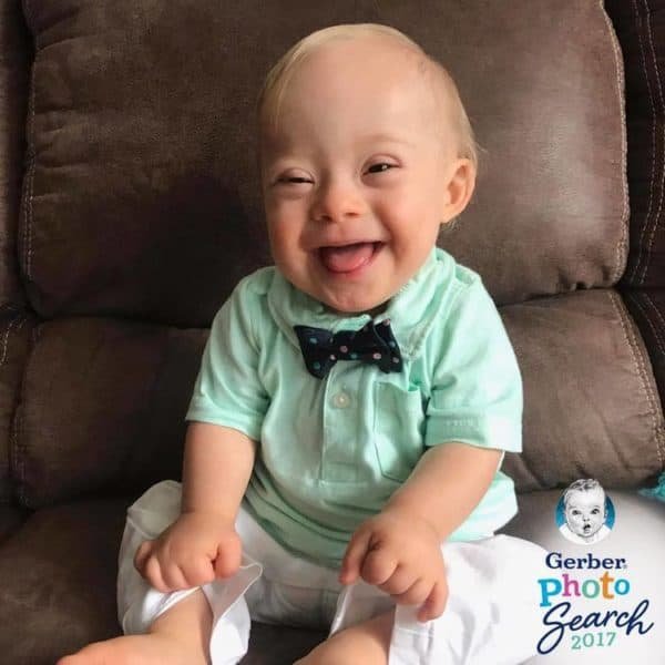 The smile on the 18 months old babies face will melt your heart because he's simply adorable.