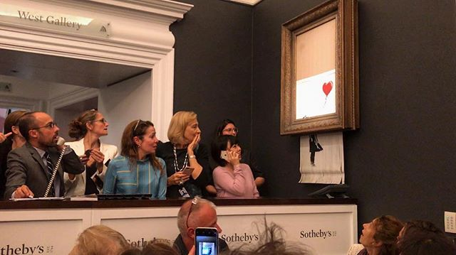 A Banksy Painting Sells For $1.4 Million . . . Then Immediately Self-Destructs (Video)