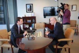 Attorney General Bob Ferguson plays a chess match with Q13 Fox News political analyst C.R. Douglas.