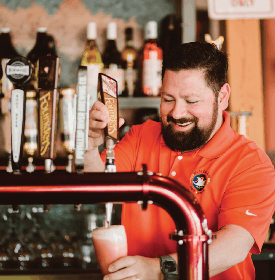 Brendon Mendoza pours a raspberry cream ale at Wingman Birdz + Brewz.