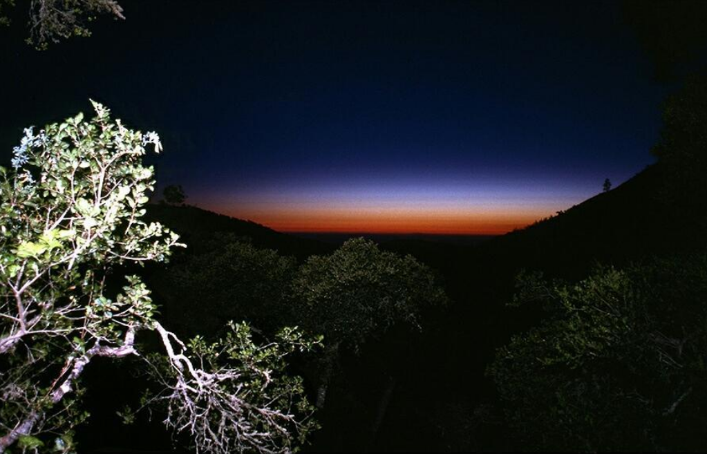 Striped sky sunset view from the cabin in the canyon. Big Sur, June 1978 by Roger Steffens