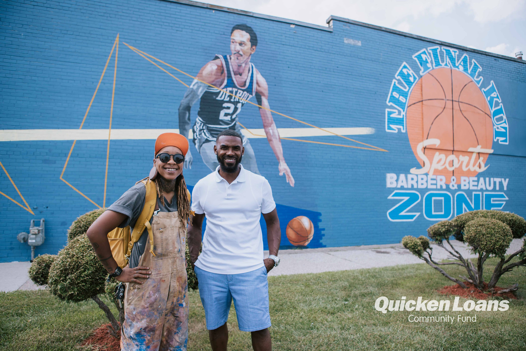 Photo of the artist Bakpak Durden and the Final Cut Barber business owner Kevin in front of the completed mural.