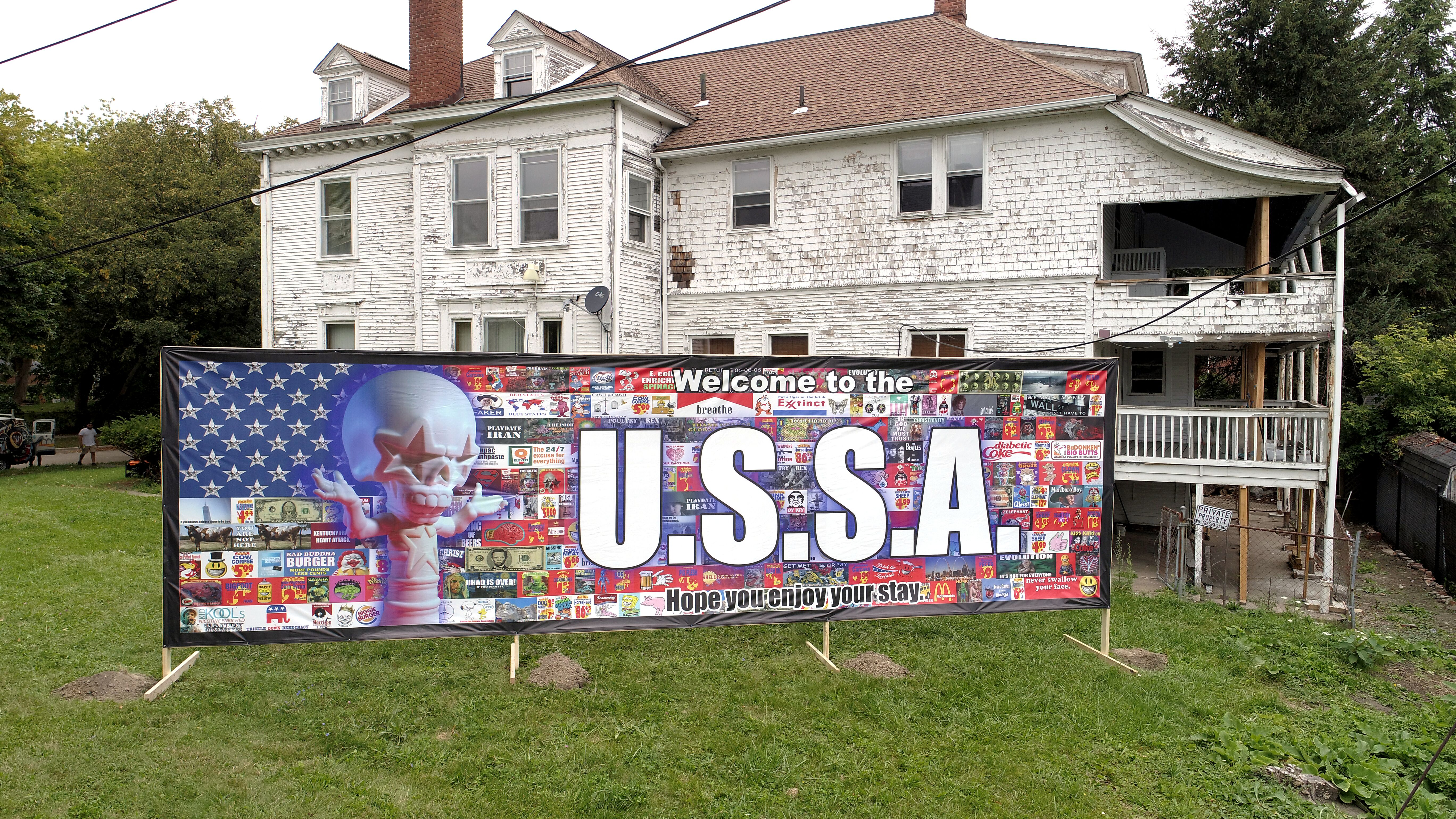 Ron English's Welcome Wall, located in Detroit's Berry Joseph Subdivision