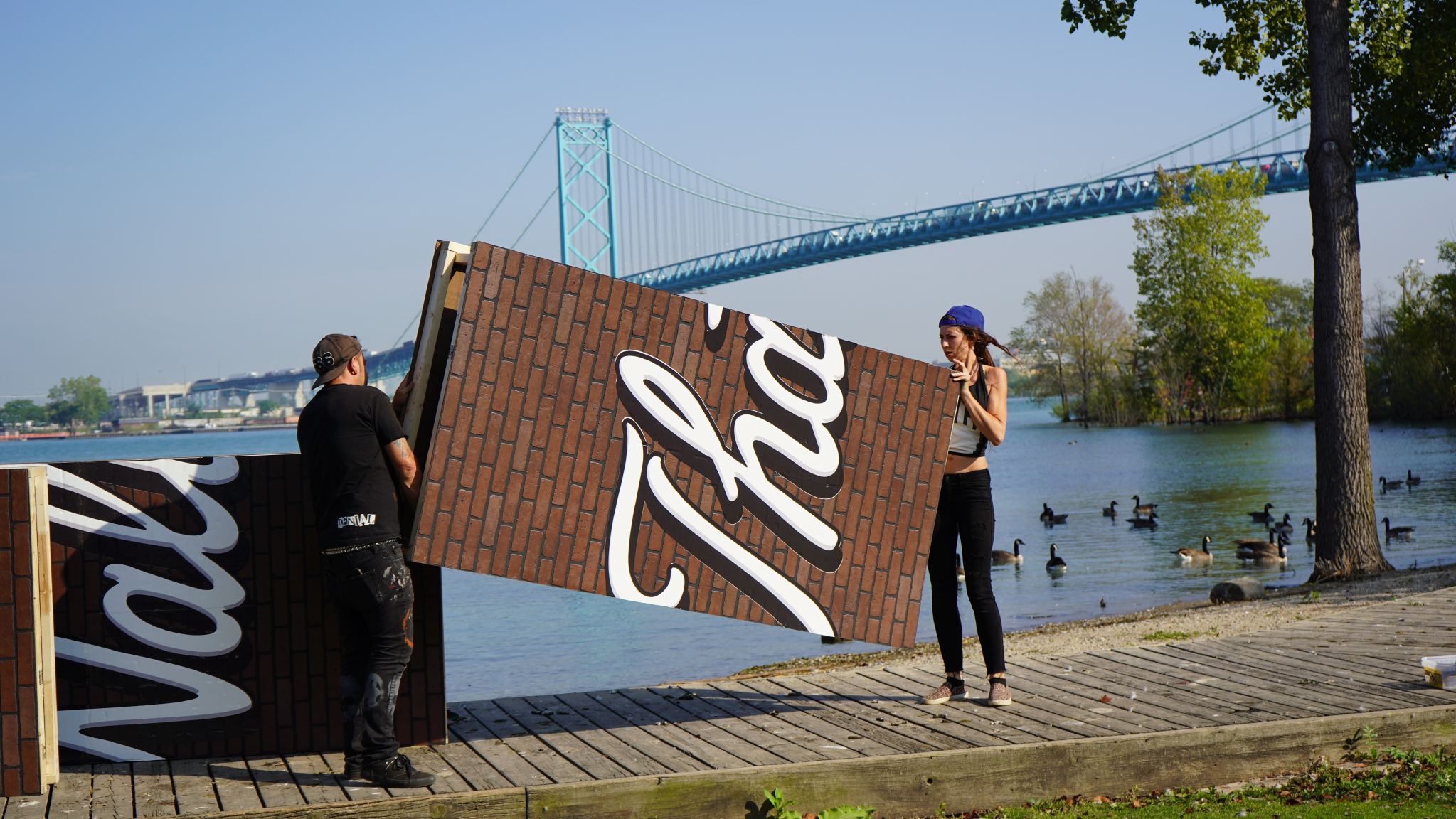 Denial installs his wall in McKee Park, Windsor, Ontario