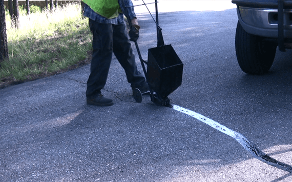 Sealing cracks in an asphalt driveway