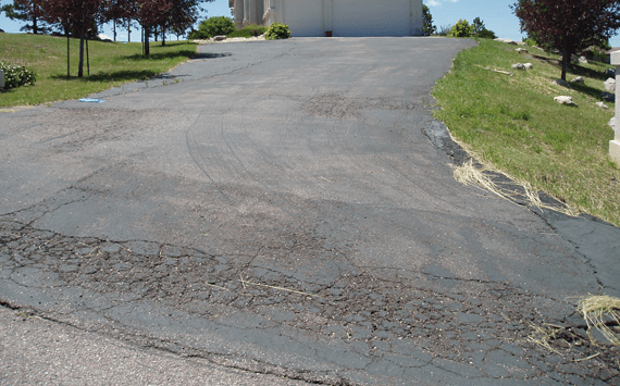 An asphalt driveway that was not maintained properly