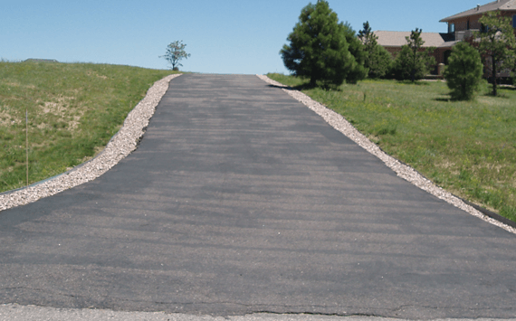 An aging asphalt driveway that needs to be re sealed