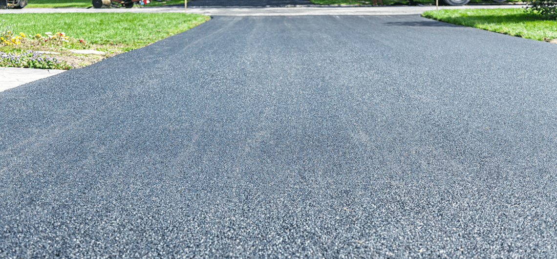A freshly installed blacktop driveway