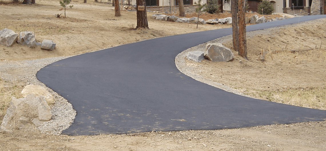 A brand new residential blacktop driveway