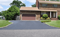 The transitions of an asphalt driveway should be the same height of the street and sidewalks so there are no trip hazards