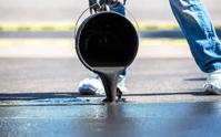 Should asphalt sealer be applied in multiple coats?