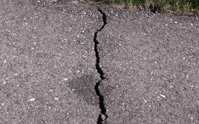 Cracks in an asphalt driveway should be kept sealed tight