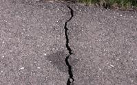 Cracks in an asphalt driveway should be kept sealed tight