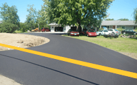 How much does seal coating an asphalt driveway cost?