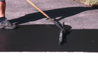 What does sealing an asphalt driveway do?