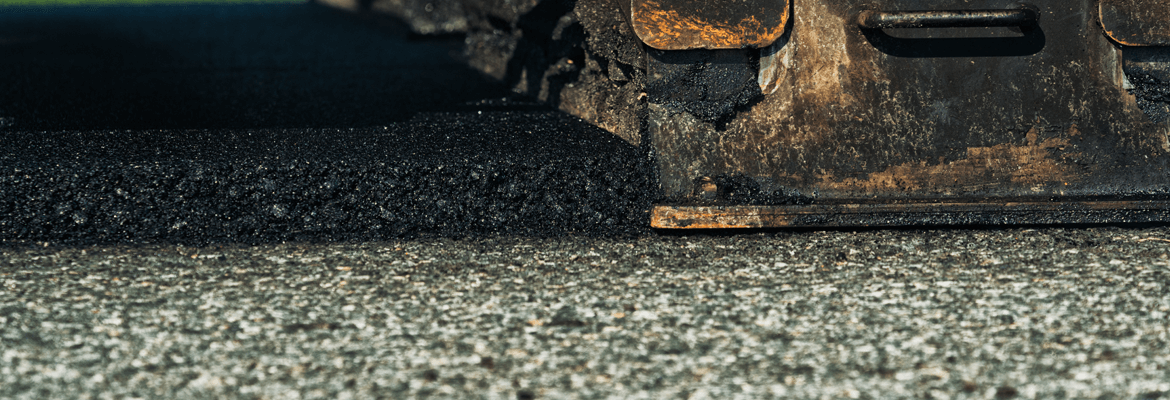 The thickness of a driveway overlay or asphalt cap