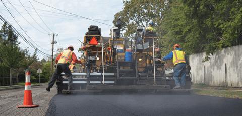 Asphalt driveway paving contractors laying asphalt