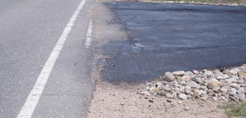 An asphalt driveway sealing scam