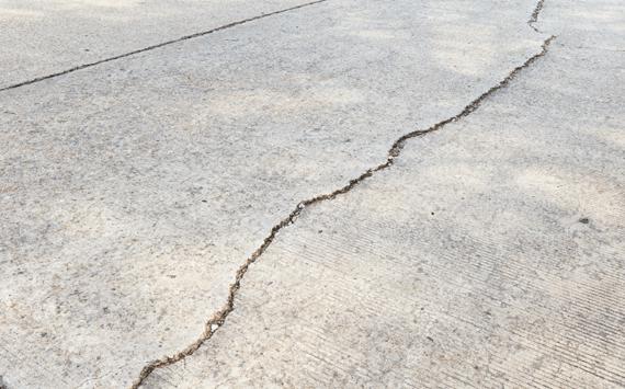 Concrete driveway crack sealing