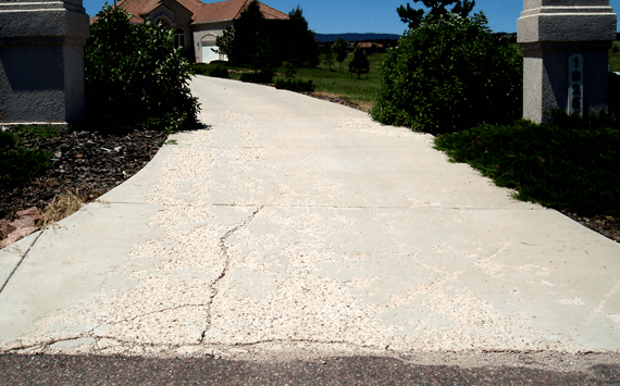 A concrete driveway that has a lot of spalling