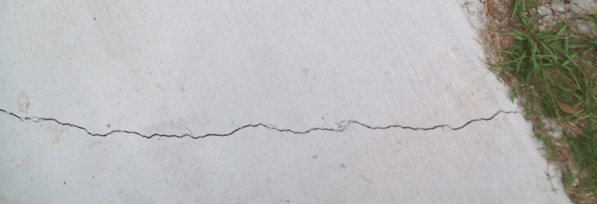 When should a concrete driveway crack?