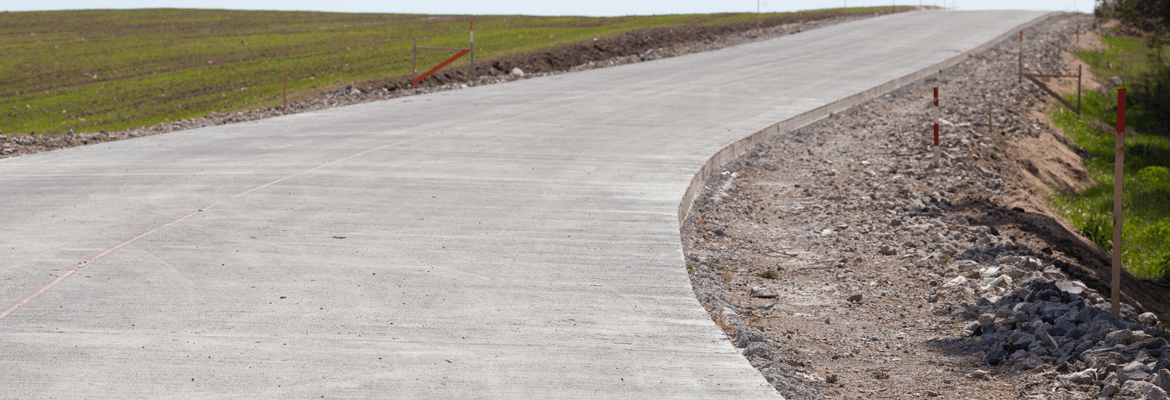 A concrete driveway should be wide enough to keep from driving off of the edges