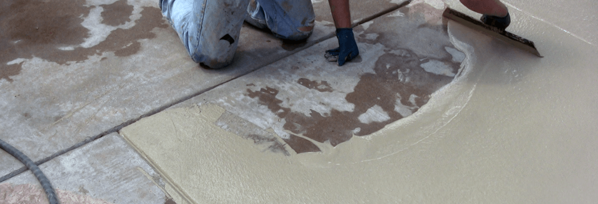 Overlaying a concrete driveway with a microtopping