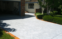 When is the best time to seal a concrete driveway?