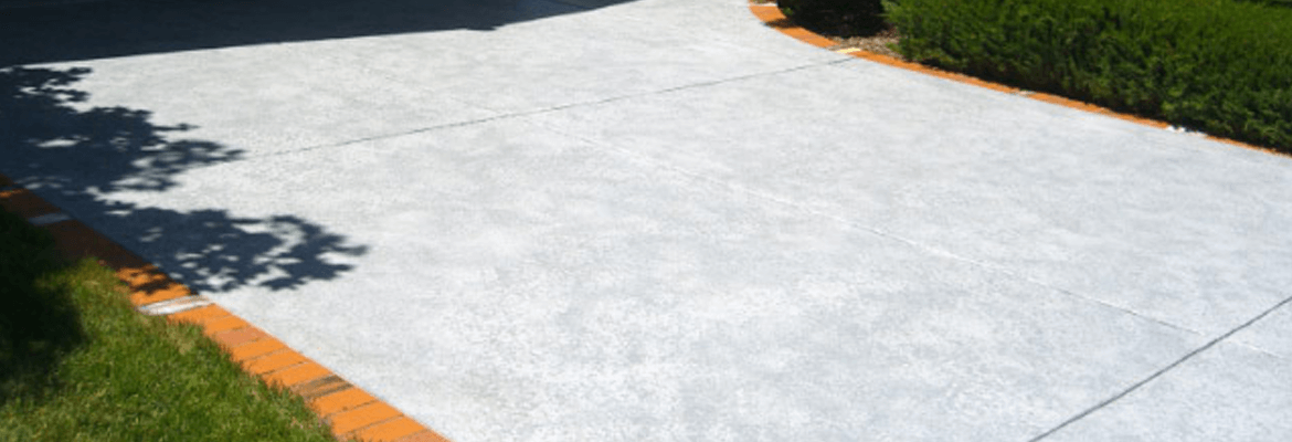 When should new concrete be sealed?