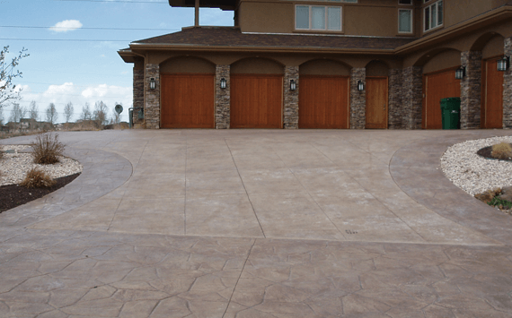 A stamped and colored concrete driveway installed by an expert concrete contractor