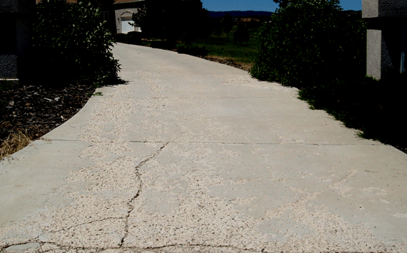 A poorly installed and poorly maintained concrete driveway installation