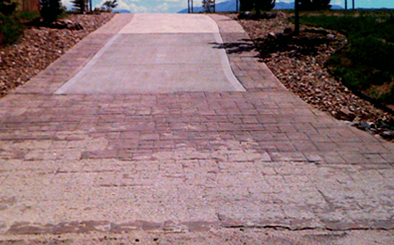 A poorly done stamped concrete driveway