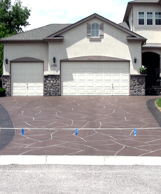A beautiful residential driveway with a stone concrete overlay {{city_county}}