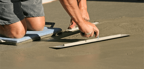 Floating a concrete driveway with hand tools