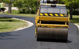 An asphalt roller compacting asphalt