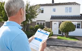 A salesman estimating a driveway